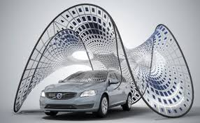 Collapsible solar pavilion charges Volvo V60, fits in its trunk