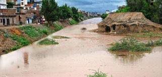 Monsoon flashfloods inundate ailing economy